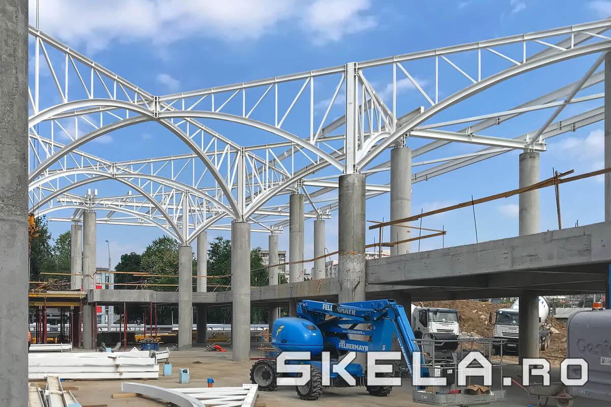 Structuri metalice arhitecturale Skela Industries - Sarpanta acoperis metalic Piata Sudului - ferme metalice cu talpa curba